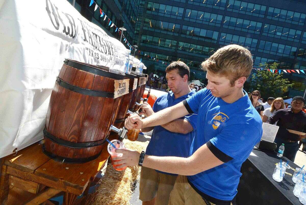 Hour Photo/Alex von Kleydorff Root Beer flows during Building and Land Technologys tennant appreciation party