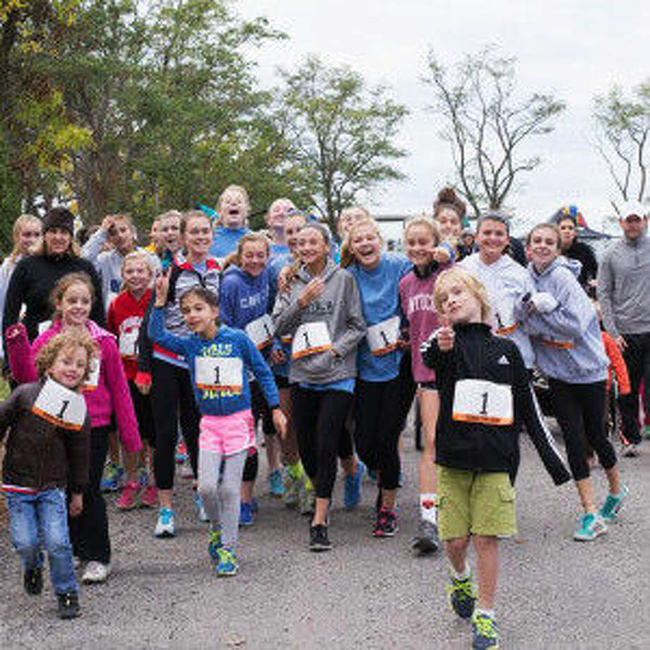Runners in the 2014 CCNS Fun Run and Family Day