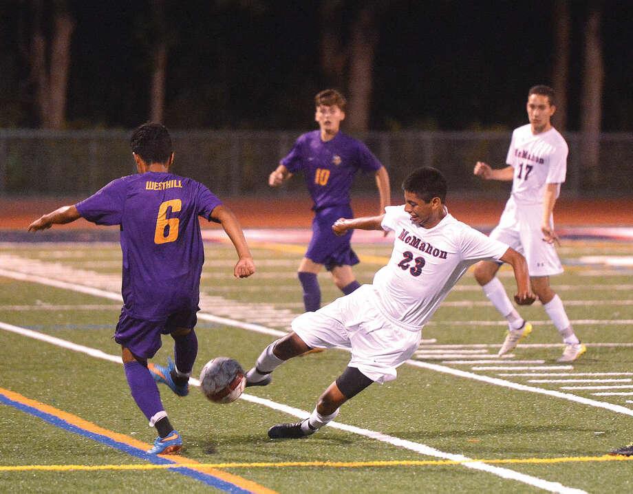 Hour Photo/Alex von Kleydorff McMahons #23 Brian Gonzalez gets the ball from Westhill
