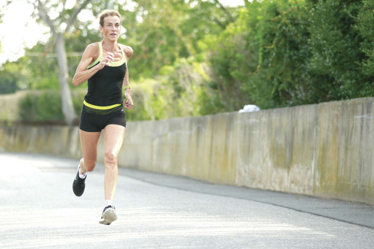 Hour photo/Chris Palermo Mary Zengo of Wilton, Conn. finishes first in the womens division of the Westport Roadrunners 8.43 mile road race in Greens Farms Saturday morning.