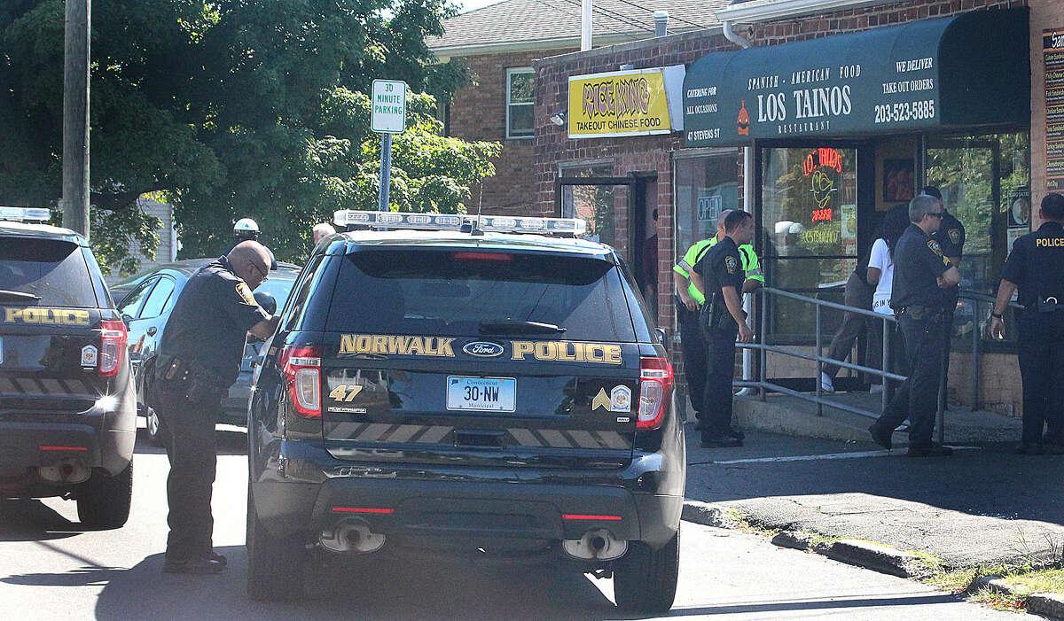 Hour photo/Chris Bosak Norwalk Police respond to a call on Stevens Street in Norwalk on Tuesday morning.