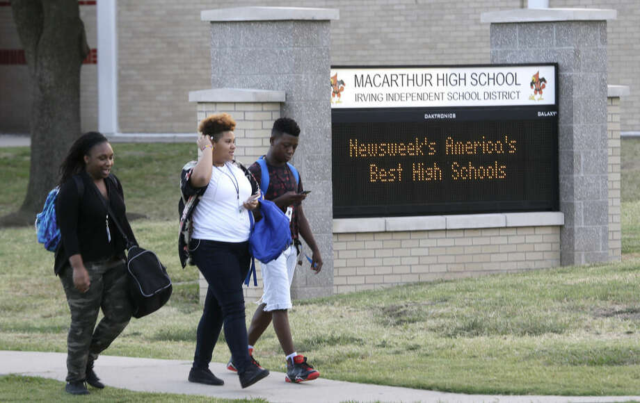 Students chat at they walk to MacArthur High School before classes start in Irving, Texas, Thursday, Sept. 17, 2015. Ahmed Mohamed, 14, was arrested at this school after a teacher thought a homemade clock he built was a bomb. The student remains suspended from attending classes today and it is unsure if he will return. (AP Photo/LM Otero)