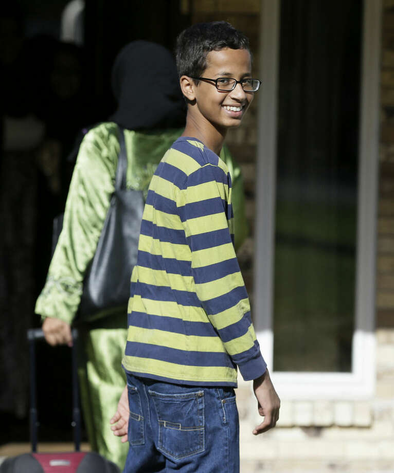 Ahmed Mohamed, 14, smiles as he arrives to his family's home in Irving, Texas, Thursday, Sept. 17, 2015. Ahmed was arrested Monday at his school after a teacher thought a homemade clock he built was a bomb. He remains suspended and said he will not return to classes at MacArthur High School. (AP Photo/LM Otero)