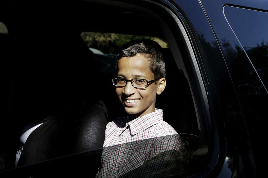 Ahmed Mohamed, 14, smiles as he sits in a vehicle before leaving his family's home in Irving, Texas, Thursday, Sept. 17, 2015. Ahmed was arrested Monday at his school after a teacher thought a homemade clock he built was a bomb. He remains suspended and said he will not return to classes at MacArthur High School. (AP Photo/LM Otero)