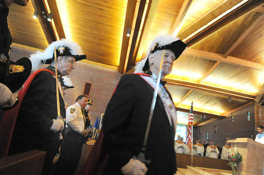 Norwalk Knights of Columbus file in Sunday at St. Matthew Church where the annual Blue Mass commemorating the 14th annivesary of 9-11 was held. Hour photo/Matthew Vinci