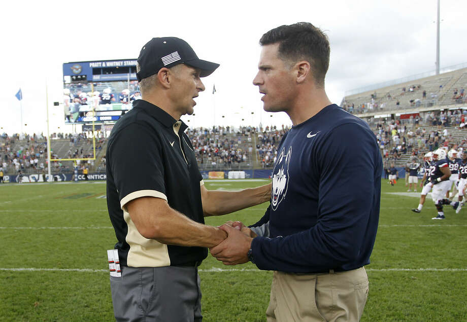 Army head coach Jeff Monken, left, shakes hands with Connecticut head coach Bob Diaco following an NCAA college football game at Pratt & Whitney Stadium at Rentschler Field, Saturday, Sept. 12, 2015, in East Hartford, Conn. Connecticut defeated Army 22-17. (AP Photo/Stew Milne)