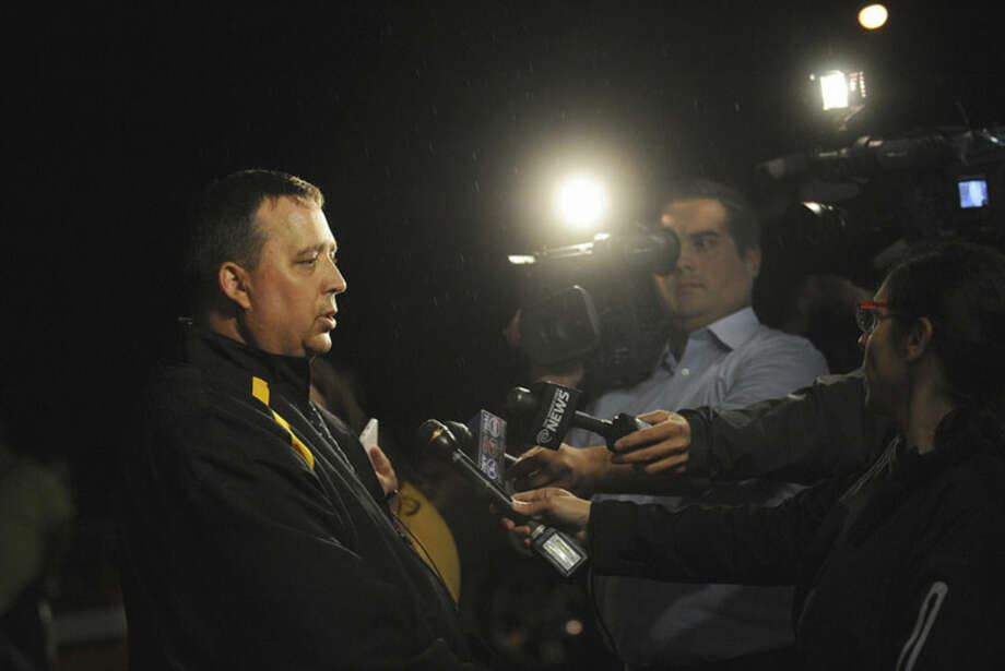 St. Lawrence County Sheriff Kevin M. Wells addresses the media Thursday night, Aug. 14, 2014 in Heuvelton after Fannie Miller, 12, and her sister Delila Miller, 6, were returned home safely after being abducted the night before. (AP Photo/The Watertown Daily Times, Jason Hunter)