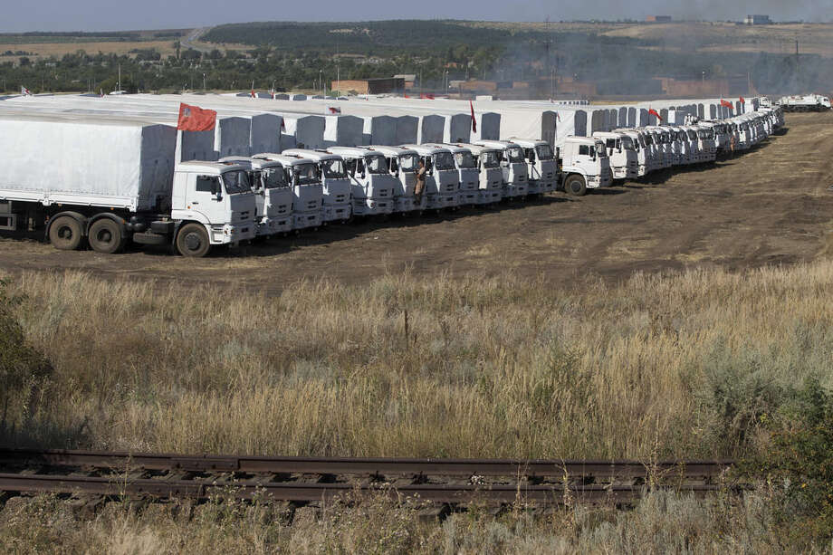 An aid convoy is parked in Voronezh, about 28 kilometers (17 miles) from Ukrainian border, Rostov-on-Don region, Russia, Friday, Aug. 15, 2014. The Ukrainian government threatened to use all means available to block the convoy if the Red Cross was not allowed to inspect the cargo. Such an inspection would ease concerns that Russia could use the aid shipment as cover for a military incursion in support of the separatists, who have come under growing pressure from government troops. (AP Photo/Pavel Golovkin)