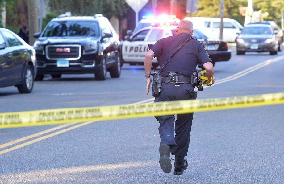 Hour Photo/Alex von Kleydorff Norwalk Police investigate a reported shooting on St John St. on Friday evening