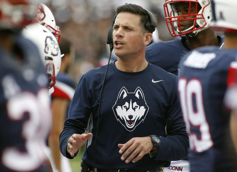 Connecticut head coach Bob Diaco talks with his defense during the fourth quarter of of an NCAA college football game against Army at Pratt & Whitney Stadium at Rentschler Field, Saturday, Sept. 12, 2015, in East Hartford, Conn. (AP Photo/Stew Milne)