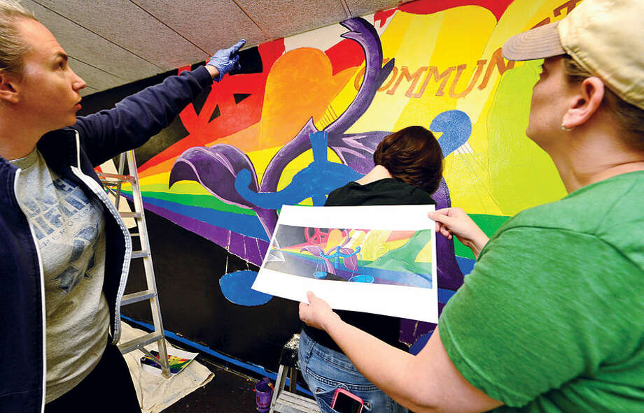 Hour photo / Erik Trautmann Epsilon employees including Kat Hastings and Melissa Bernfeld paint a mural at Trailblazers Academy Charter Middle School in Stamford that represents ways school staff help children build skills to heal from trauma they have experienced.