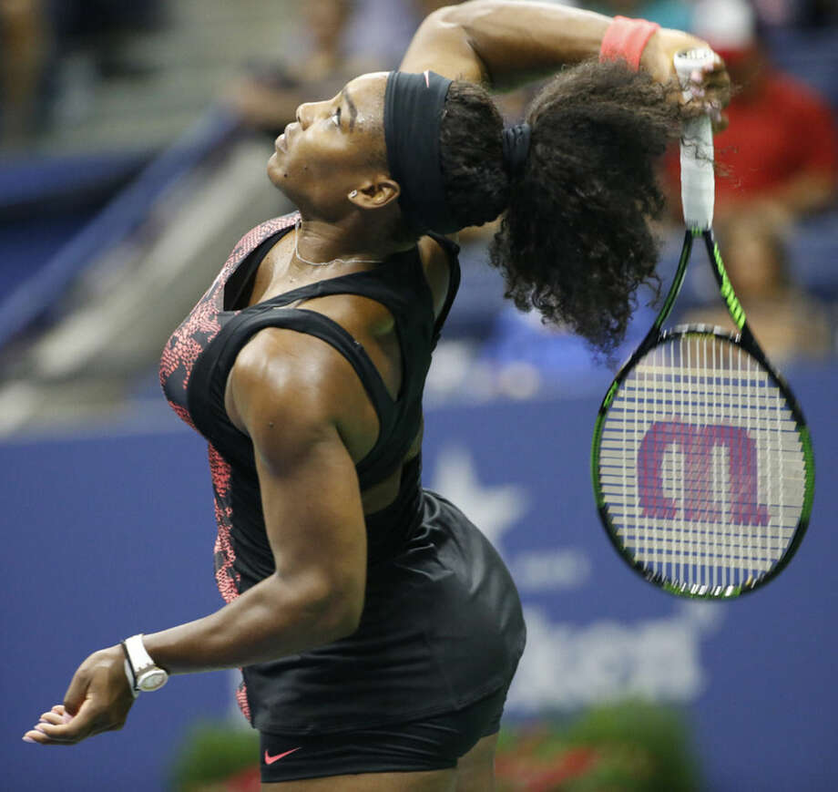 Defending U.S. open champion Serena Williams of the United States serves during her first round match against Vitalia Diatchenko of Russia in the U.S. Open tennis tournament at the Billie Jean King USTA National Tennis center in New York, Monday, Aug. 31, 2015. (AP Photo/Kathy Willens)