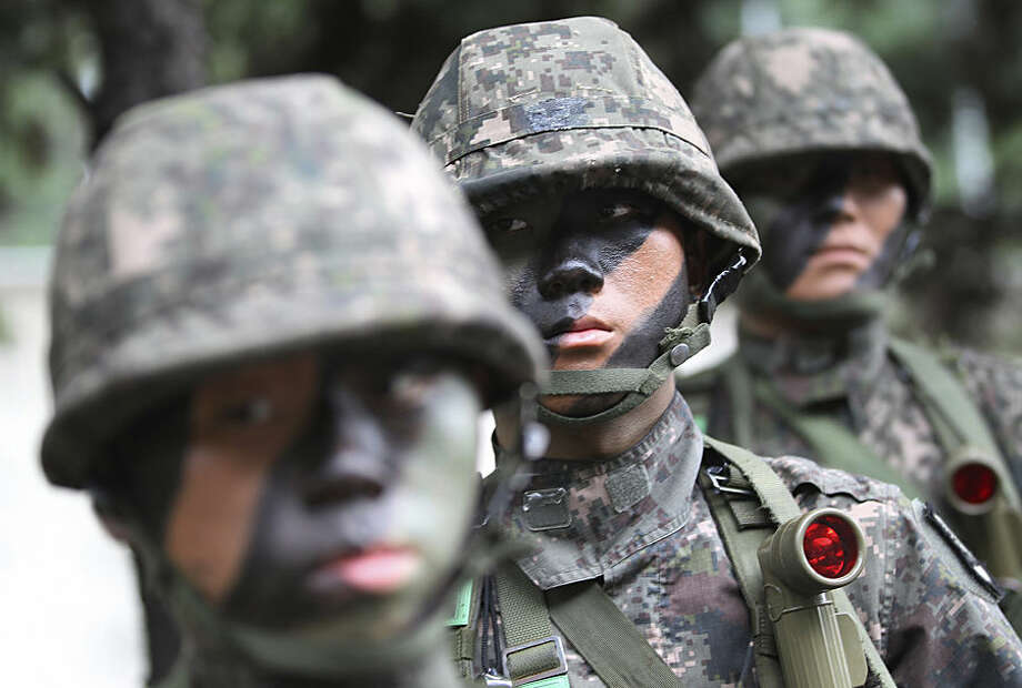 South Korean army soldiers take part in an anti-terror exercise as part of Ulchi Freedom Guardian in Seoul, South Korea, Monday, Aug. 18, 2014. The U.S.-South Korean military exercises starting Monday and involving tens of thousands of troops are described by the allies as routine and defensive, but Pyongyang sees them as invasion preparation. (AP Photo/Ahn Young-joon)