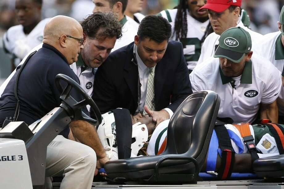New York Jets outside linebacker Lorenzo Mauldin is carted off the field during the second half of an NFL football game against the Cleveland Browns Sunday, Sept. 13, 2015 in East Rutherford, N.J. The Jets won 31-10. (AP Photo/Jason DeCrow)