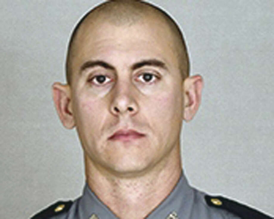 This undated photo provided by the Kentucky State Police shows Trooper Joseph Cameron Ponder. Ponder, who had been on the force less than a year was killed, late Sunday, Sept. 13, 2015, in a shooting during a car chase. Authorities are searching for the suspect. (Courtesy of the Kentucky State Police via AP)