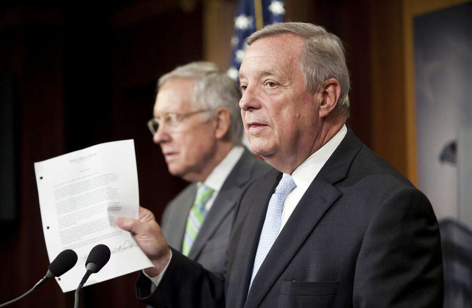 FILE - In this Sept. 10, 2015, file photo, Senate Minority Whip Richard Durbin of Ill., right, with Senate Minority Leader Harry Reid of Nev., holds up a copy of a letter signed by Senate Republicans, that was sent to leader of Iran, as they answer questions for reporters following the Senate vote on the Iran nuclear agreement on Capitol Hill in Washington. Senate Republicans will try a second time to move ahead on a resolution rejecting the Iran nuclear deal. (AP Photo/Pablo Martinez Monsivais, File)
