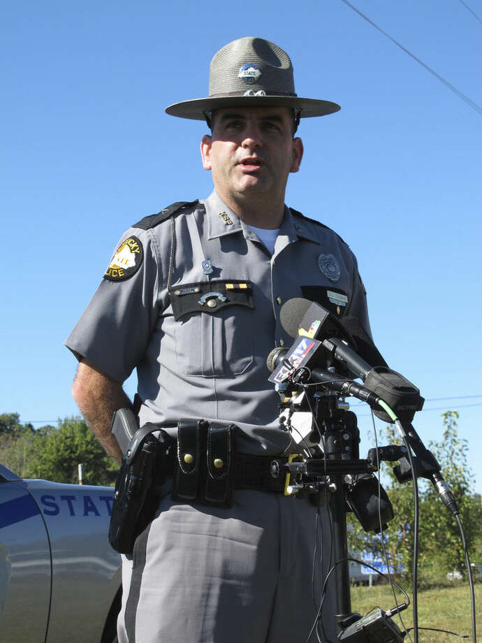 Kentucky State Police Trooper Jay Thomas discusses the death of fellow KSP Trooper Joseph Cameron Ponder on Monday, Sept. 14 near Eddyville, Ky. Police said Ponder was killed in a shooting during a chase late Sunday night in western Kentucky. (AP Photo/Bruce Schreiner)