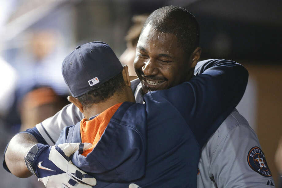 Houston Astros' Chris Carter celebrates with teammates after hitting a three-run home run during the ninth inning of a baseball game against the New York Yankees on Tuesday, Aug. 19, 2014, in New York. (AP Photo/Frank Franklin II)
