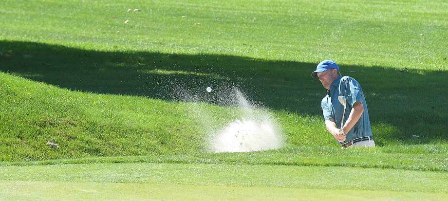 Hour Photo/Alex von Kleydorff Brent Dietz out of a trap during the Courville Tournament at Shorehaven CC on Tuesday