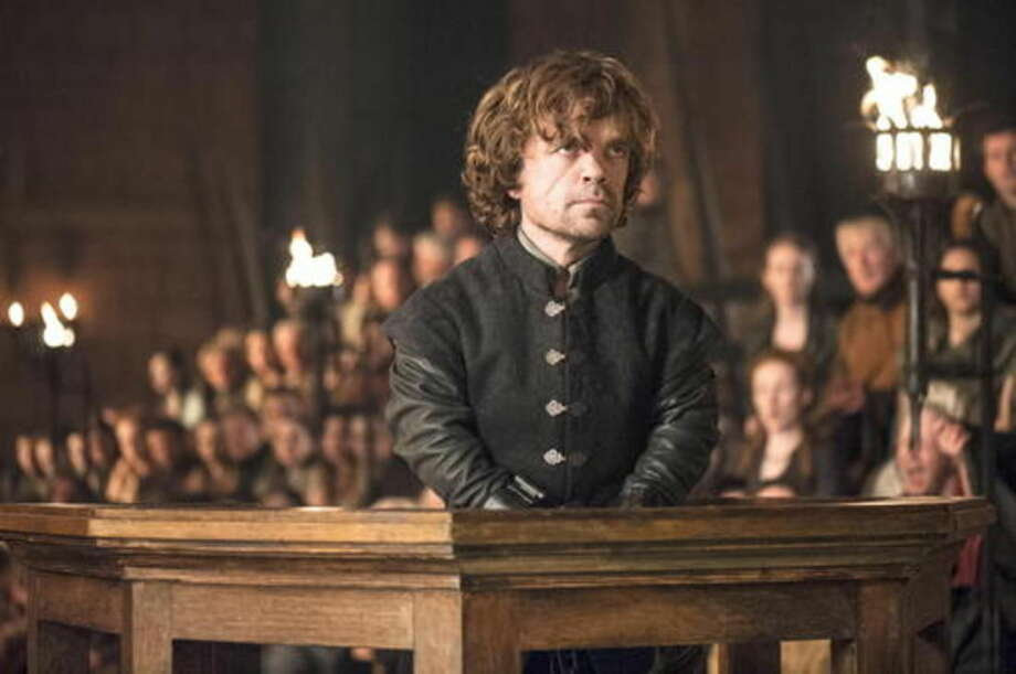 """This image released by HBO shows Peter Dinklage in a scene from """"Game of Thrones."""" (AP Photo/HBO, Helen Sloan)"""
