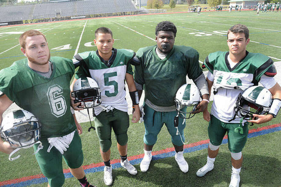 Norwalk Football captains, Eddie O'Harra, Brandan Brown, Anthony Wooten and Harrison Hefferan. Hour photo/Matthew Vinci