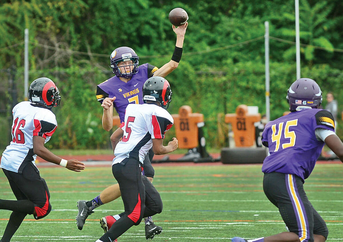 Quarterback Blake Newcomer looks to pass as Westhill High School takes on Bridgeport Central Saturday in Stamford.