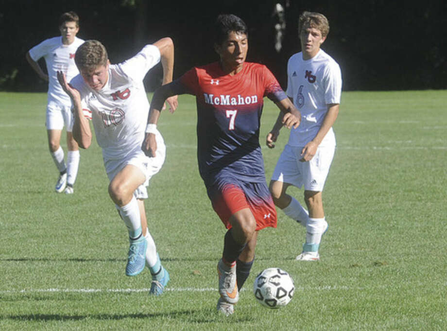 Hour photo/Matthew VinciBrien McMahon's Afa Reyes (7) races upfield with the ball in front of New Canaan's Brett Capone during Tuesday's game in New Canaan.