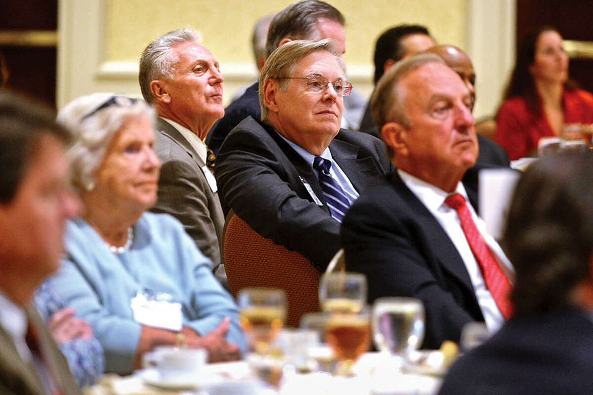 Hour photo / Erik Trautmann Norwalk mayor, Harry Rilling, and Stamford mayor, David Martin, center, listen to the keynote speaker at a Stamford Chamber of Commerce luncheon at the Stamford Marriot Wednesday, Connecticut's Department of Transportation Commissioner, James Redeker, outlines the ambitious, Let's GO CT, a multi-billion dollar, decade-spanning, comprehensive plan that is aimed to revamp Connecticut's roadways and other modes of transportation.