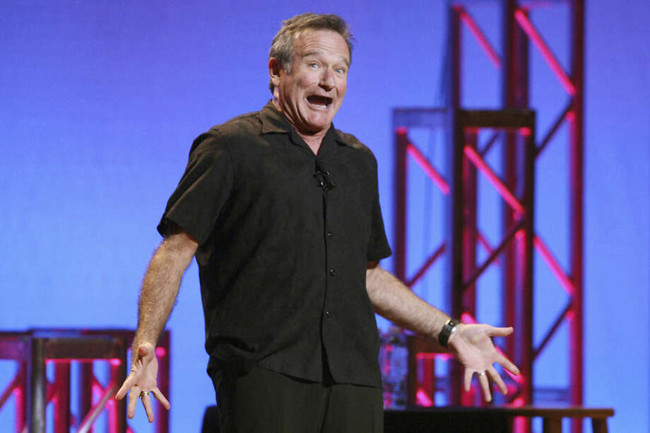 """This Nov. 23, 2009 photo released by Starpix shows actor-comedian Robin Williams performing his stand-up show, """"Weapons of Self Destruction,"""" at Town Hall in New York. After thousands of fans petitioned the creators of the online role-playing video game """"World of Warcraft"""" to memorialize Williams, the game's lead designer said Thursday that Blizzard Entertainment planned to create a character inspired by the actor, comedian and avid gamer, who died Monday, Aug. 11 of an apparent suicide at the age of 63. Williams was a notable fan of the massively multiplayer fantasy game, which is currently played online by about 6.8 million people. (AP Photo/Starpix, Dave Allocca)"""
