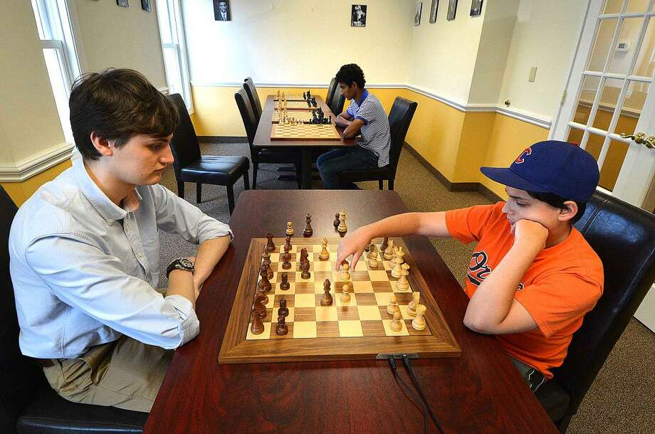Hour Photo/Alex von Kleydorff Instructor Curt Rubin calls out the moves student 11yr old Matthew Weinstock as he plays a game againts a 'blind' Kapil Chandran who can only hear the moves but can not see the peices on the board and must play from memory