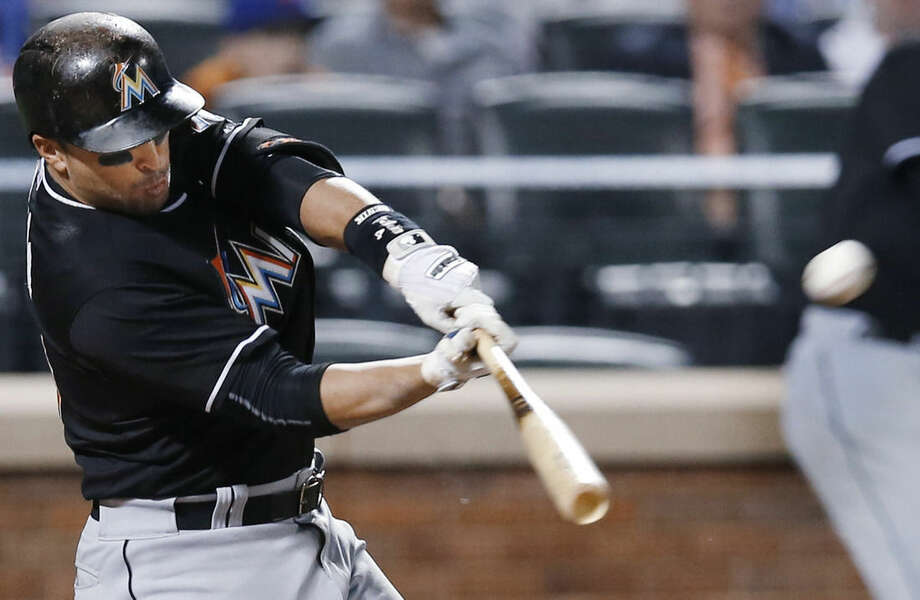 Miami Marlins' Martin Prado hits a fourth-inning solo home run in a baseball game against the New York Mets in New York, Wednesday, Sept. 16, 2015. (AP Photo/Kathy Willens)
