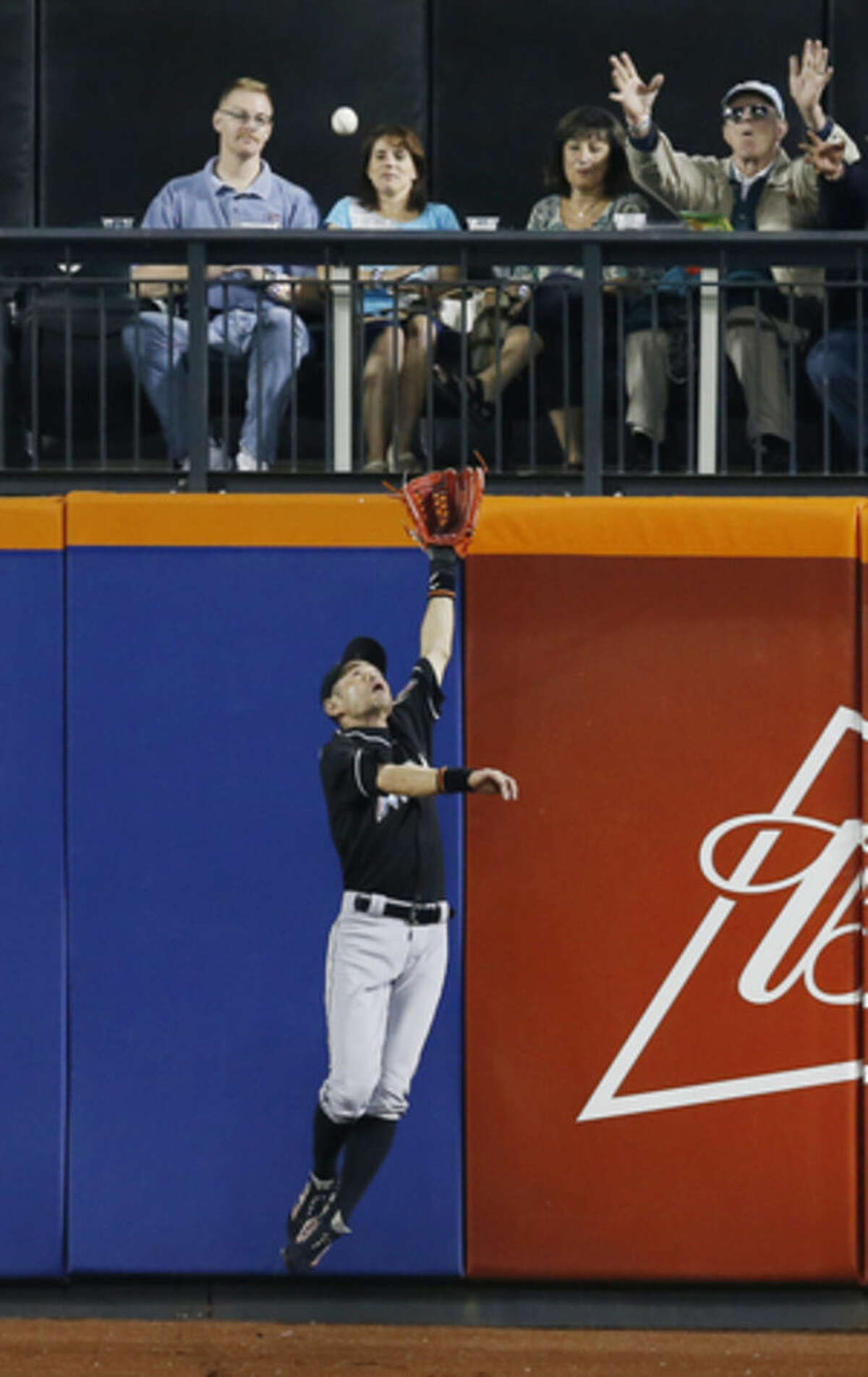 Miami Marlins left fielder Ichiro Suzuki leaps for a third-inning double by New York Mets' David Wright during a baseball game Wednesday, Sept. 16, 2015, in New York. (AP Photo/Kathy Willens)