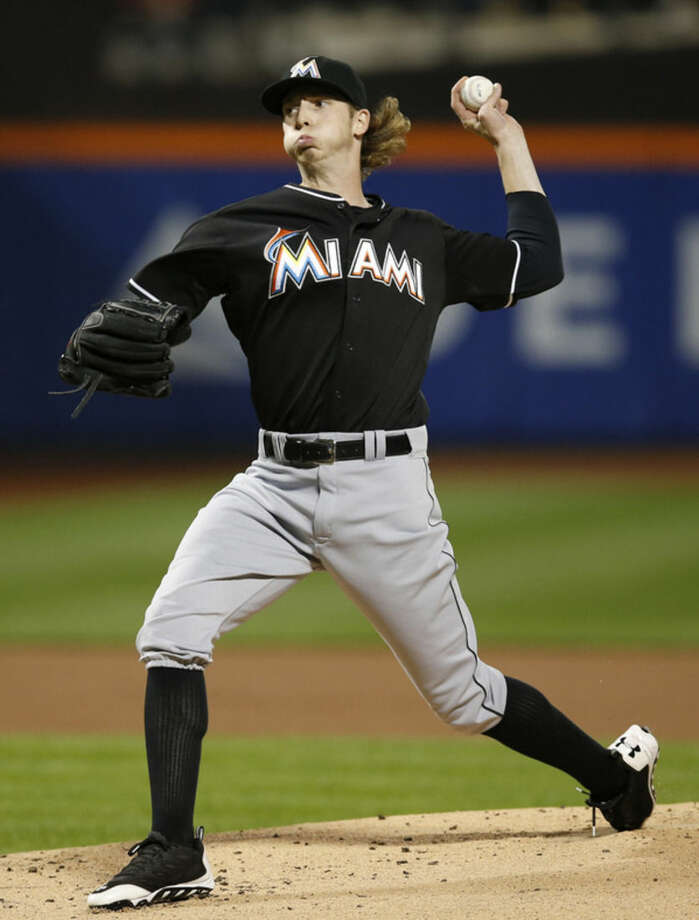 Miami Marlins relief pitcher Adam Conley delivers during the first inning of a baseball game against the New York Mets in New York, Wednesday, Sept. 16, 2015. (AP Photo/Kathy Willens)