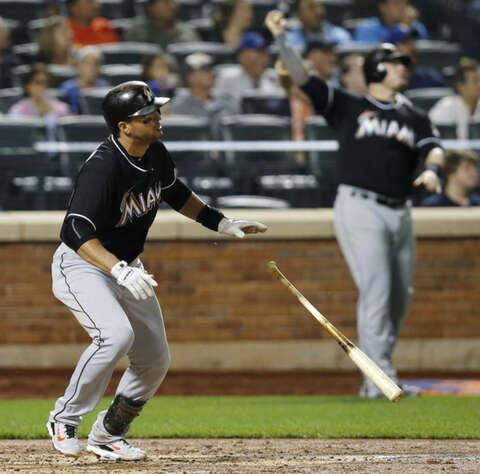 7eab4cdd <p>Miami Marlins' Martin Prado watches a fourth-inning solo home run