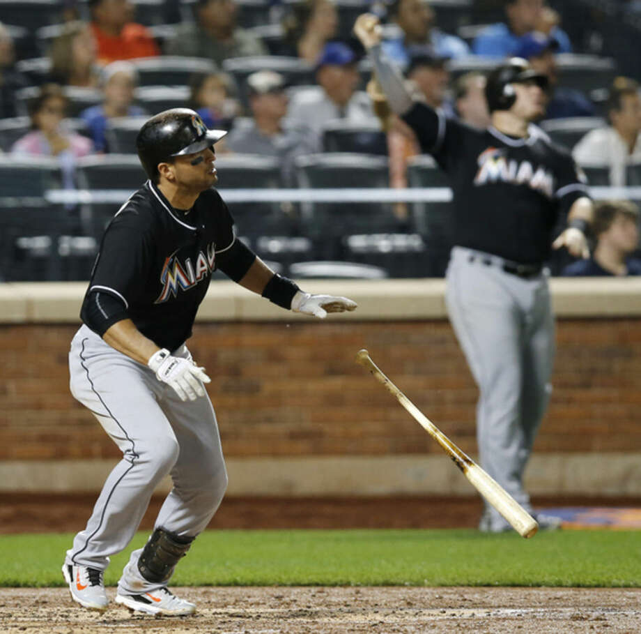 Miami Marlins' Martin Prado watches a fourth-inning solo home run in a baseball game against the New York Mets in New York, Wednesday, Sept. 16, 2015. On-deck batter Justin Bour is at right. (AP Photo/Kathy Willens)