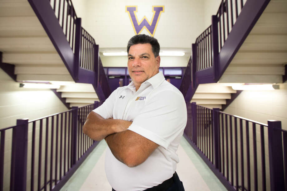 Hour photo/Chris Palermo. West Hill High School's new Athletic Director Larry Savo poses for a portrait Wednesday.