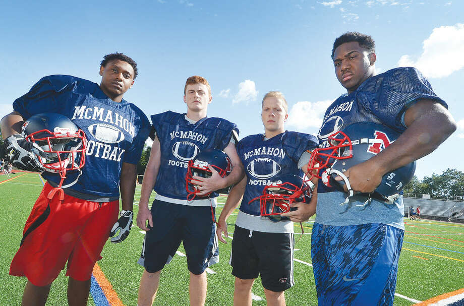 Brien McMahon High School football captains for this fall season are, from left, seniors Roshad Russell, Dylan Finn, Spencer Wellen and Theo Wilton. The Senators open the season Friday at Wilton.(Hour photo/Alex von Kleydorff)