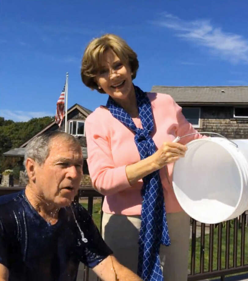 In this image from video posted on Facebook, courtesy of the George W. Bush Presidential Center, former President George W. Bush reacts after participating in the ice bucket challenge with the help of his wife, Laura Bush, in Kennebunkport, Maine. The challenge has caught on with notable figures participating in the campaign to raise money for the fight against ALS, or Lou Gehrig's disease. (AP Photo/Courtesy George W. Bush Presidential Center)
