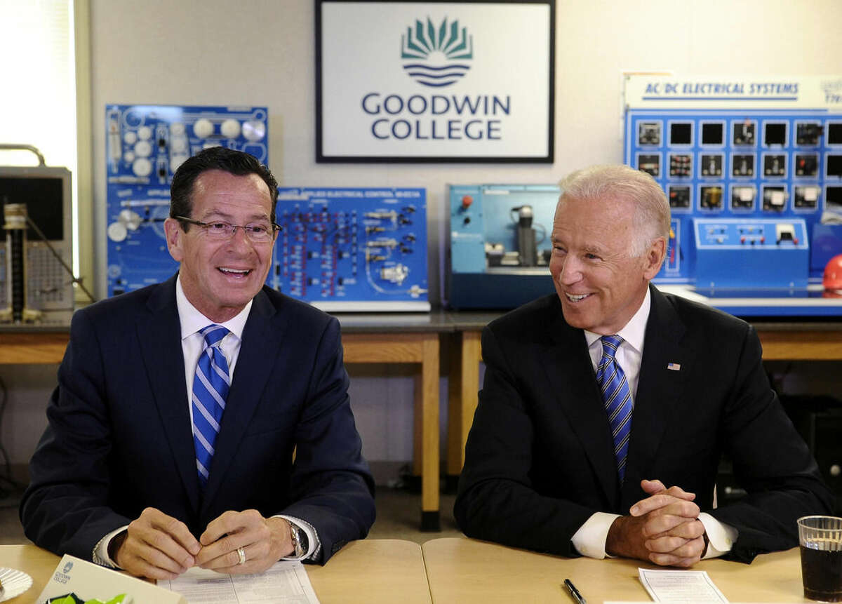 Vice President Joe Biden and Connecticut Gov. Dannel P. Malloy attend a roundtable on workforce development at Goodwin College, Wednesday, Aug. 20, 2014, in East Hartford, Conn. Biden said manufacturing jobs are coming back to the US, but workers need the right training to fill those positions. Biden credited efforts in Connecticut, including Goodwin College in East Hartford, to match job training with the needs of large and small manufacturers. He called it a model for the rest of the nation. (AP Photo/Jessica Hill)