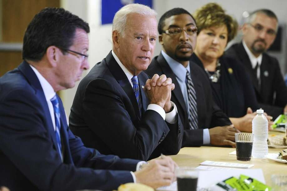 Vice President Joe Biden, second from left, speaks with Connecticut Gov. Dannel P. Malloy, left, during a roundtable on workforce development at Goodwin College, Wednesday, Aug. 20, 2014, in East Hartford, Conn. (AP Photo/Jessica Hill)