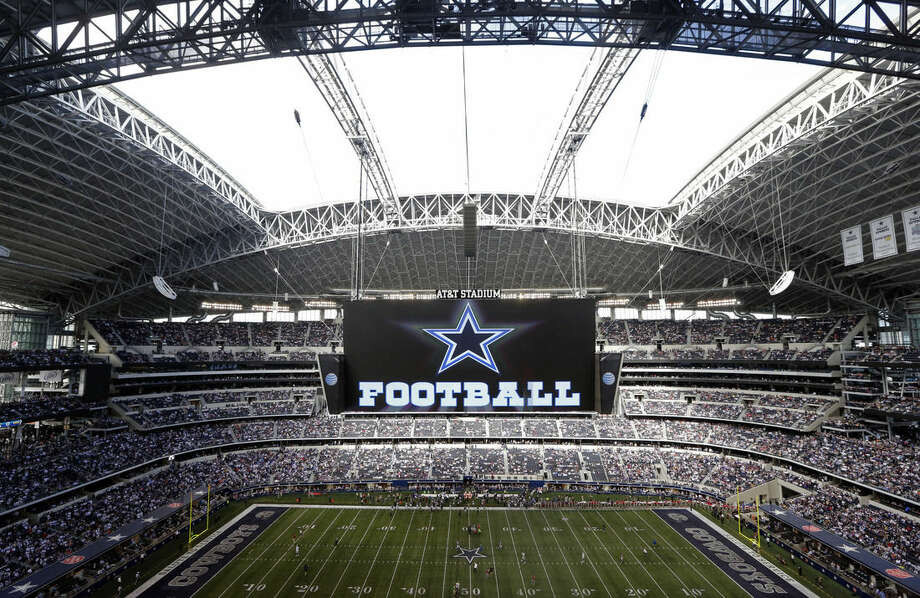 FILe - In this Nov. 3, 2013, file photo, the roof is open on the stadium before an NFL football game between the Dallas Cowboys and the Minnesota Vikings in Arlington, Texas. Forbes says Cowboys are the first U.S. sports franchise to top $3 billion in value. For the eighth straight year, the Cowboys are worth the most of all 32 NFL franchises, valued at $3.2 billion. (AP Photo/Sharon Ellman, File)