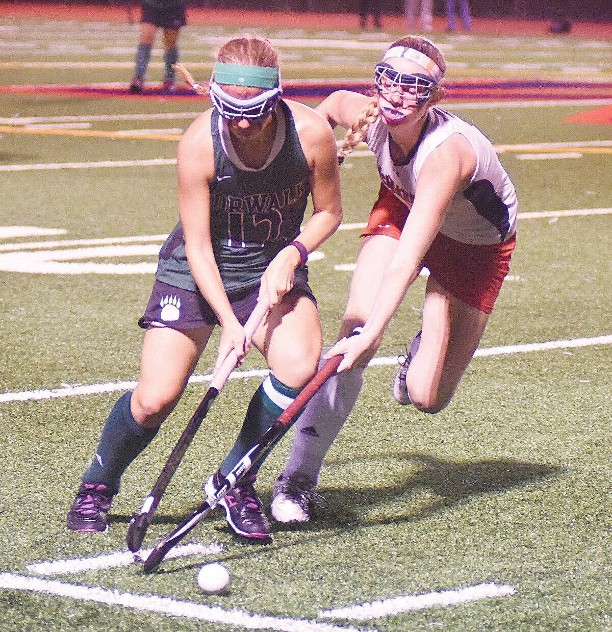Hour photo/John Nash - Norwalk's Lauren Capone keeps possession of the ball as she deals with the defense of Brien McMahon's Stephanie Mangels during Wednesday's matchup at Casagrande Field in Norwalk. Norwalk won 8-0.