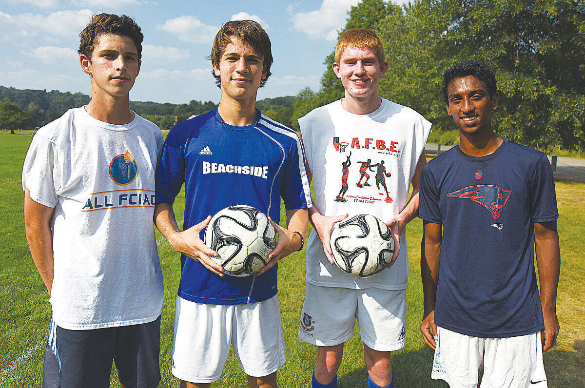Wilton boys soccer captains.