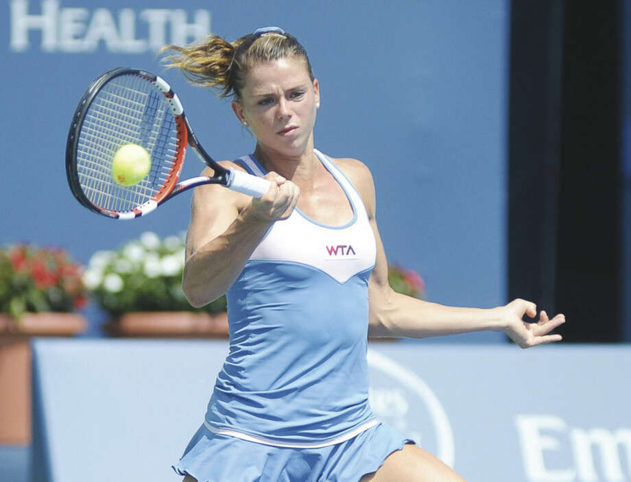 Hour photo/John NashCamila Giorgi hits a running forehand winner during her 6-4, 6-2 upset victory over Caroline Wozniacki during Wednesdays' Round of 16 match at the Stadium Court at the Connecticut Open Tennis Tournament at Yale University in New Haven.