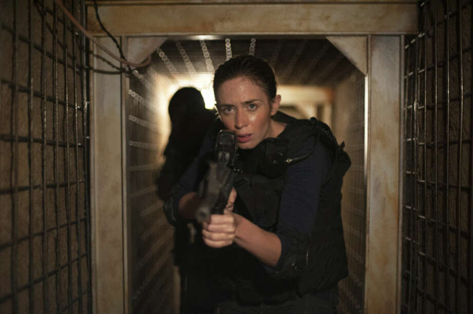 "This photo provided by Lionsgate shows, Emily Blunt, as Kate Macer, in a scene from the film, ""Sicario."" (Richard Foreman, Jr. SMPSP/Lionsgate via AP)"