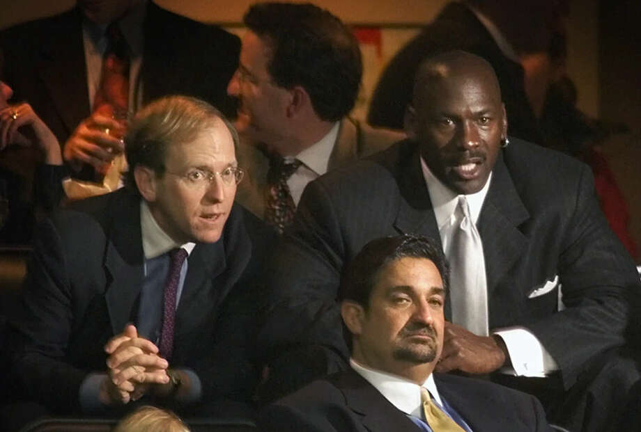 "FILE - In this Jan. 19, 2000, file photo, former Chicago Bulls great Michael Jordan, rear right, sits in the owner's sky box with Washington Capitals minority owner Jon Ledecky, left, and Washington Wizards minority owner Ted Leonsis, front, during an NBA game at the MCI Center in Washington. The Islanders have announced that the team is being sold to a former Washington Capitals co-owner and a London-based investor. In a statement Tuesday, Aug. 19, 2014, the team says a group led by former Capitals co-owner Jon Ledecky and investor Scott Malkin has reached an agreement to buy a ""substantial"" minority interest in the team. (AP Photo/Pablo Martinez Monsivais. File)"