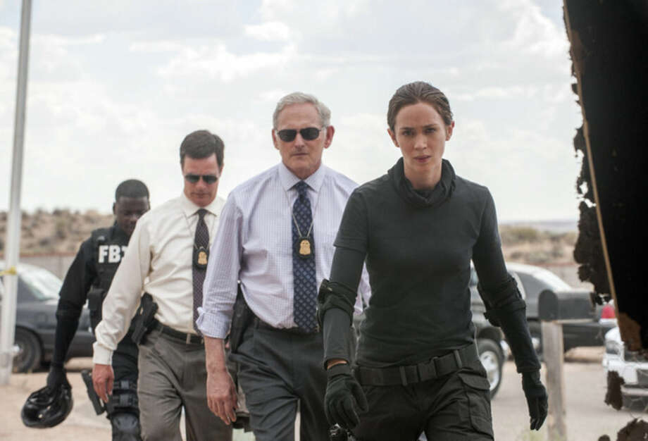 """This photo provided by Lionsgate shows, Daniel Kaluuya, from rear left, as Reggie Wayne, Phil Coopers as Hank Rogerson, Victor Garber as Dave Jennings, and Emily Blunt, as Kate Macer, in a scene from the film, """"Sicario."""" (Richard Foreman, Jr. SMPSP/Lionsgate via AP)"""