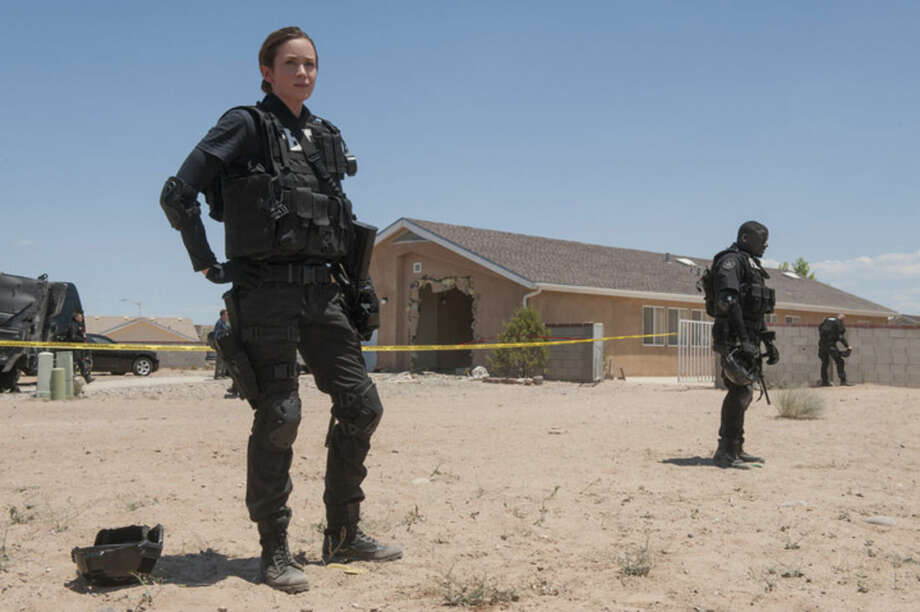 """This photo provided by Lionsgate shows, Emily Blunt, as Kate Macer, in a scene from the film, """"Sicario."""" (Richard Foreman, Jr. SMPSP/Lionsgate via AP)"""