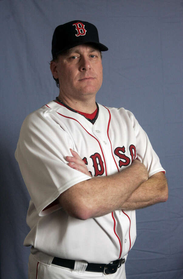 FILE - This is a Feb. 24, 2008 file photo showing Boston Red baseball player Curt Schiling. Former major league pitcher Curt Schilling says he's battling mouth cancer and blames 30 years of chewing tobacco use. Schilling discussed details of his cancer on WEEI-FM in Boston on Wednesday, Aug. 20, 2014. (AP Photo/Steven Senne, File)
