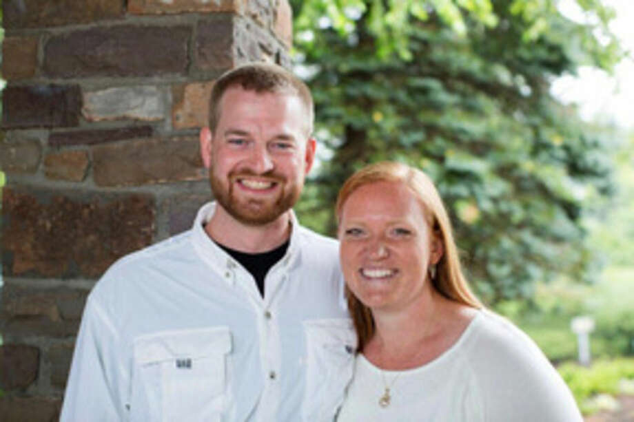 FILE - This undated photo provided by Samaritan's Purse shows Dr. Kent Brantly and his wife, Amber. A spokesperson for the Samaritan's Purse aid organization said that Dr. Kent Brantly, one of the two American aid workers infected with the Ebola virus in Africa, would be released Thursday, Aug. 21, 2014. (AP Photo/Samaritan's Purse)